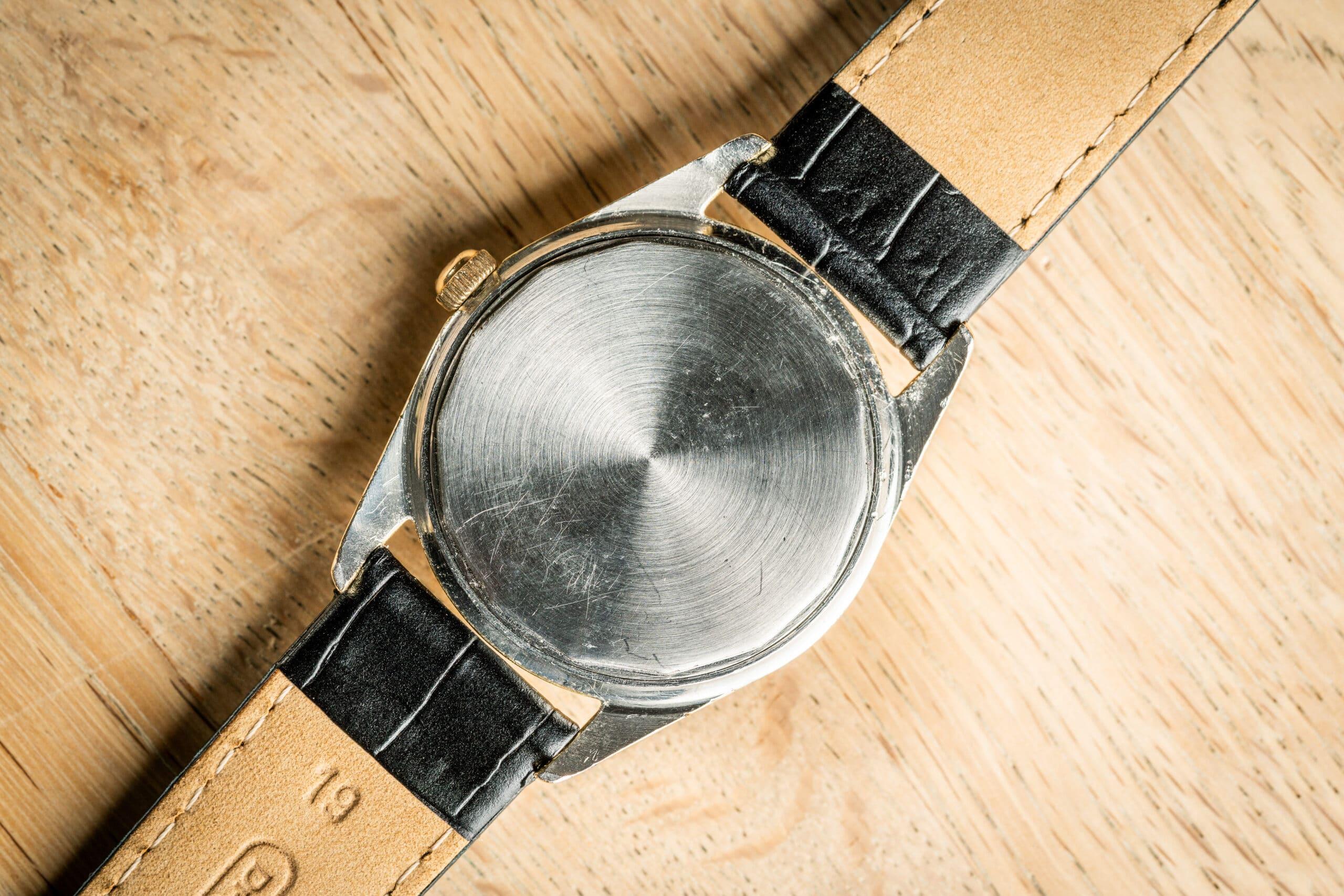 vintage universal geneve polerouter date watch caseback